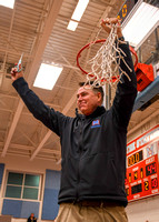 Marshall Varsity Boys' Basketball cuts down the nets and CELEBRATES a National District Championship. 2-16-18